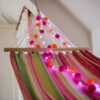 Orange and pink festival pom pom fairy lights with Pink LED lights