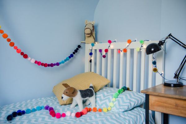 Rainbow Pom Pom Garland in bedroom