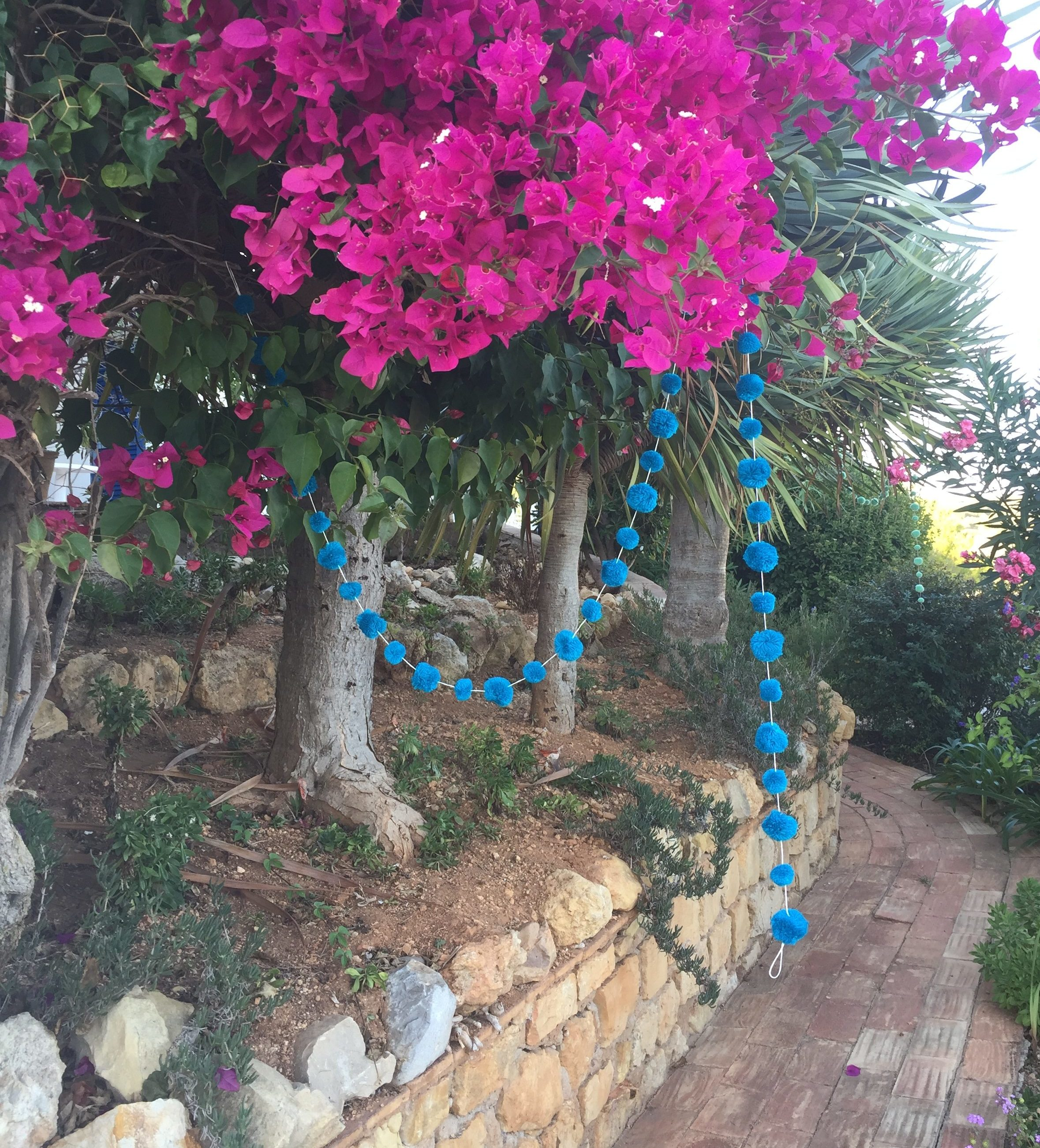 Turquoise Teal Pom Pom Garland Hanging in Pink tree