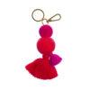 pom pom and tassel key ring clip with flamingo pink pom poms and tassel and gold clip and split ring