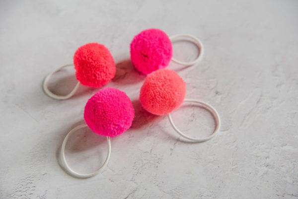 Pinks set of 4 Pom pom hair bobbles that come in a gift tube