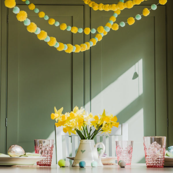 Yellow Pom Pom garland with mint and yellow garland above table