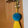 Jumbo pom pom and tassel bag swag Turquoise pom pom and yellow tassel