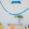 Turquoise Pom Pom Garland with Neo mint by Pompom Galore above a kitchen table