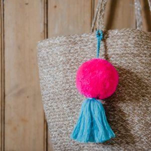 Jumbo pom pom and tassel bag swag Neon Pink with light blue tassel