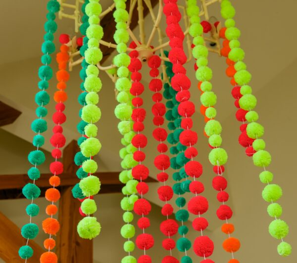Pom Pom Garlands Hanging with Fluro in the middle