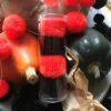Halloween orange and black pom pom hair bobbles set of 4 in a tube