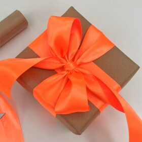 Brown paper and orange satin ribbon