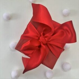 Red gift wrap and satin bow